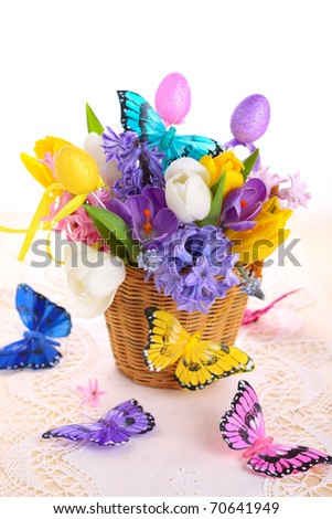 Beautiful spring flowers with decorative butterflies isolated on white background - stock photo