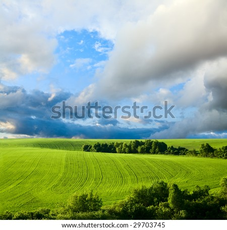 beautiful spring landscape and cloudy sky