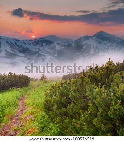 Beautiful spring sunset in the mountains - stock photo