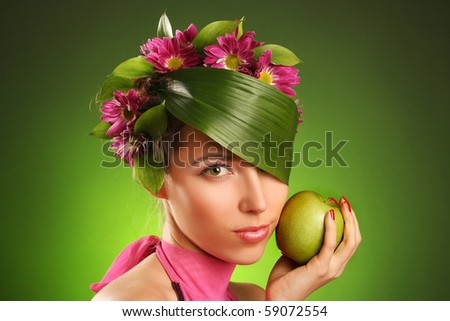 beautiful spring-woman with green apple - stock photo