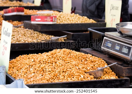 Beautiful stack of cashew nuts for sale in a market stall in Breda, The Netherlands on a traditional season market - stock photo