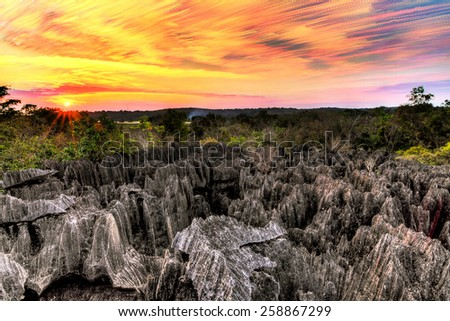 Beautiful stacked image at sunset of the unique landscape at the Tsingy de Bemaraha Strict Nature Reserve in Madagascar - stock photo