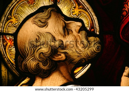 Beautiful stained glass depicting a Saint looking up - stock photo
