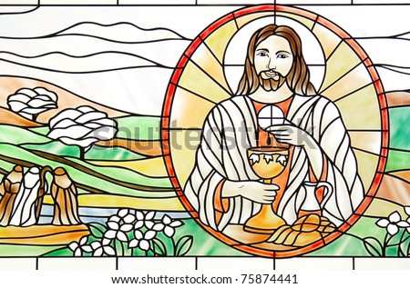 Beautiful stained glass in Catholic church of the Christians. - stock photo