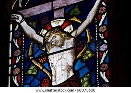 Beautiful stained glass window depicting Jesus on the crucifix - stock photo