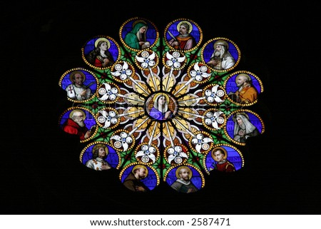 Beautiful stained glass window in church of Santa Maria Sopra Minerva in Rome - stock photo
