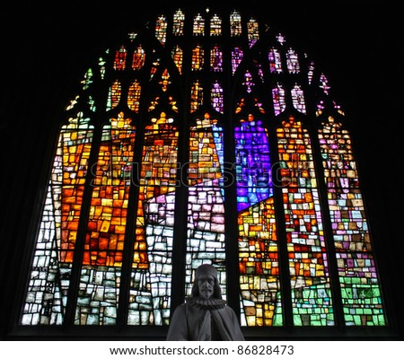 Beautiful stained glass window of Manchester Cathedral. - stock photo