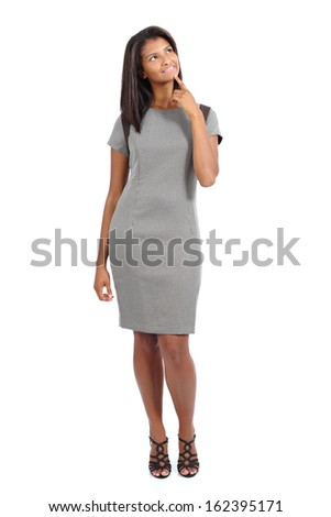 Beautiful standing african american model woman thinking and looking above isolated on a white background                - stock photo