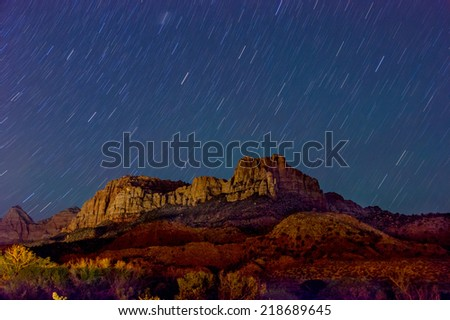 beautiful starry sky at night over zion national park - stock photo