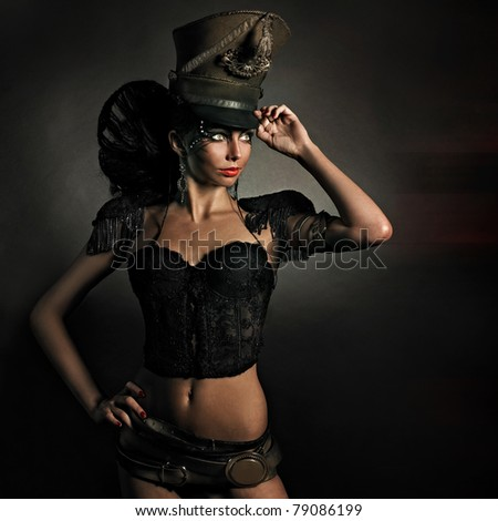 Beautiful steam punk lady in retro uniform on dark background - stock photo