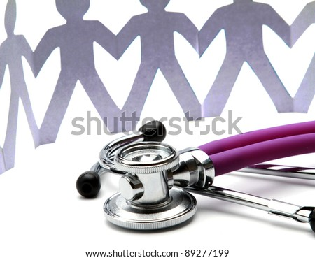 Beautiful stethoscope with paper people - stock photo