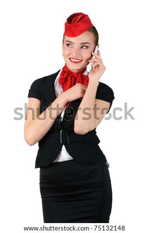 beautiful stewardess speaking on the phone - stock photo