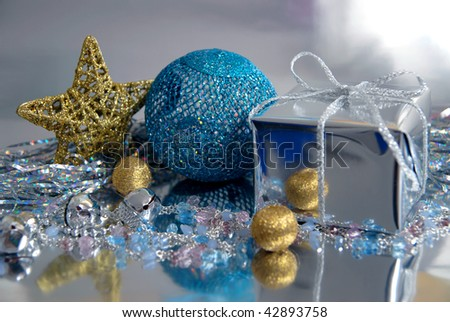 Beautiful still-life in blue, gold and silver tones, executed from New Year's attributes. It is devoted Christmas and New Year.