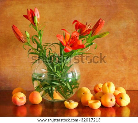 Beautiful still life with lilies and apricots - stock photo
