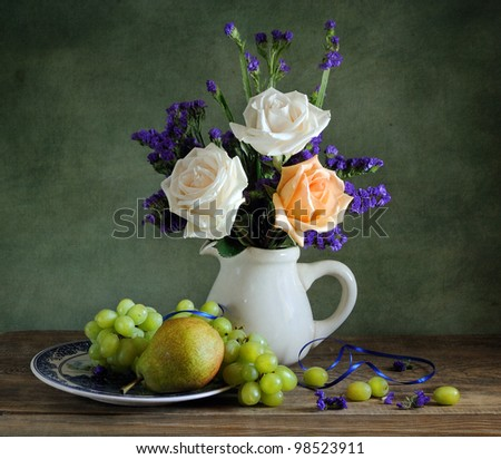Beautiful still life with roses and fruit