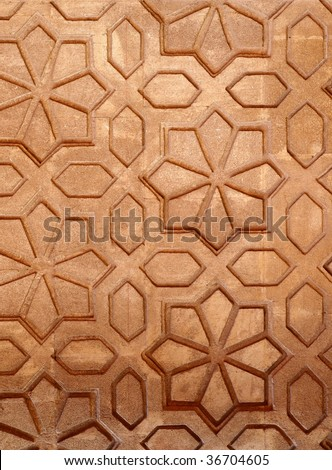 Beautiful stone carvings on the wall of a house is Marrakech, Morocco - stock photo