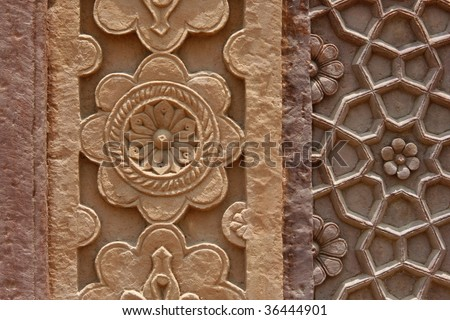 Beautiful stone carvings on the wall of an abandoned Fatehpur Sikri temple in India, Rajasthan region - stock photo