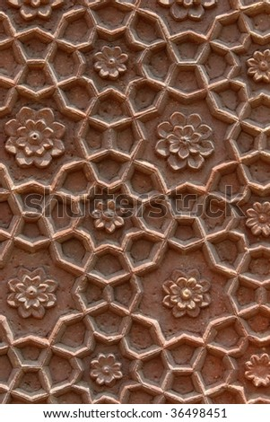 Beautiful stone carvings on the wall of an abandoned temple in India, Rajasthan region - stock photo