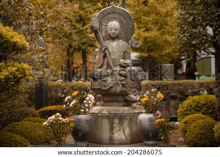 Beautiful stone sculpture of monk in Japan. - stock photo