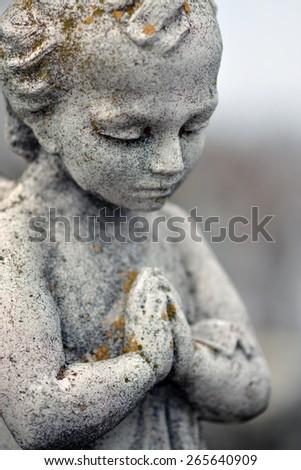 Beautiful stone statue of praying angel - stock photo