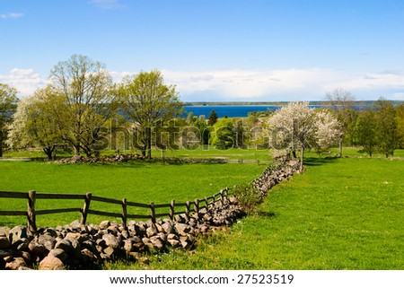 Beautiful stone wall in a spring landscape - stock photo