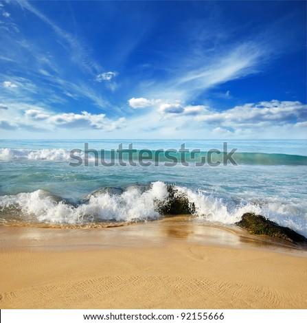 beautiful stones in the waves on ocean coast - stock photo