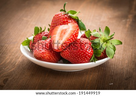 Beautiful strawberries on the wooden table  - stock photo