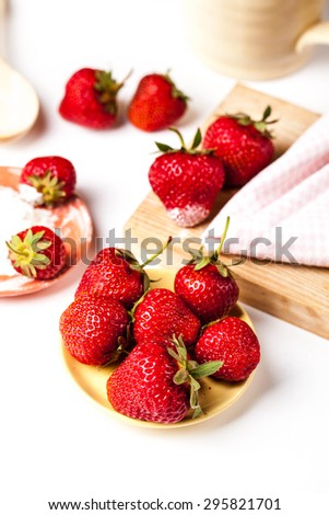 Beautiful strawberries with powdered sugar and tea towels. fruit - stock photo