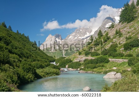 beautiful stream between rocks in Veny valley, Courmayeur. Italy - stock photo