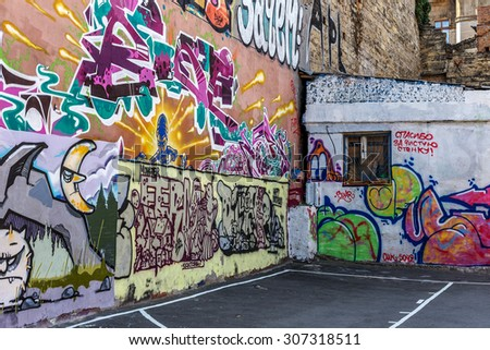 Beautiful street art graffiti. Abstract creative drawing fashion colors on the walls of the city. Urban Contemporary Culture. The inscription on the wall - Thanks for the clean wall