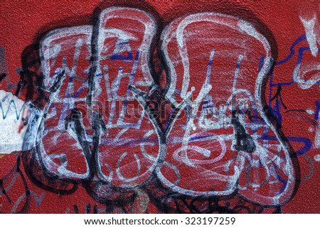 Beautiful street art of graffiti. Abstract color creative drawing fashion on the walls of the city. Urban contemporary culture. The writing on the walls. The protest culture