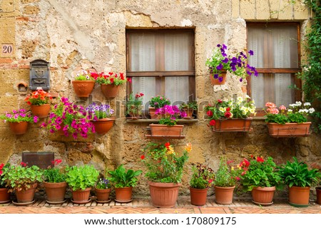 Beautiful street decorated with flowers in Italy - stock photo