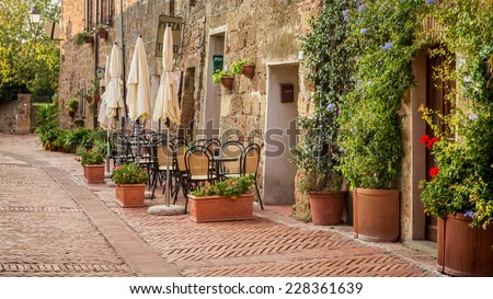 Beautiful street decorated with flowers, Italy - stock photo