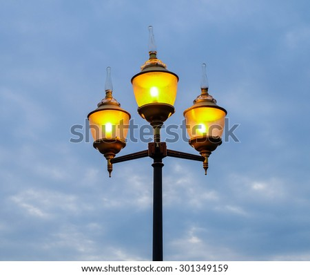 Beautiful street lamp on evening sky background - stock photo