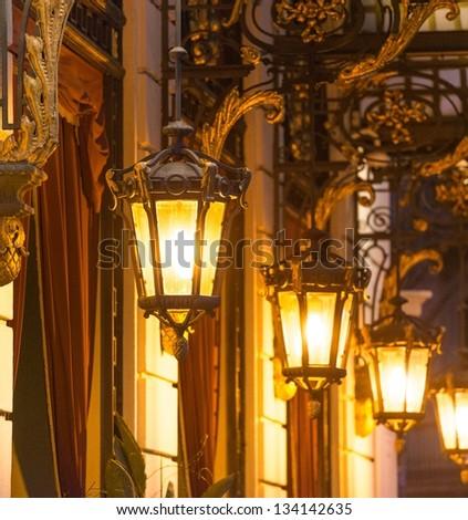 Beautiful street lanterns illuminated at night - stock photo