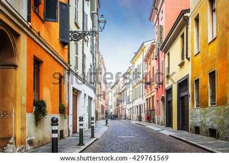 Beautiful street with residential houses in Parma, Emilia-Romagna province, Italy. - stock photo