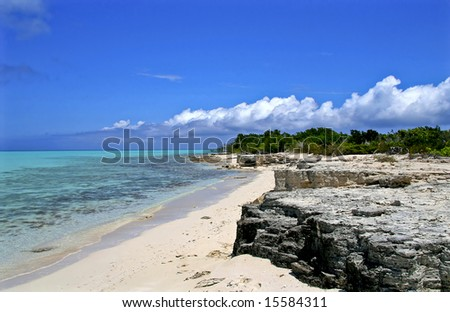 Beautiful stretch of tropical shoreline covered with limestone. - stock photo