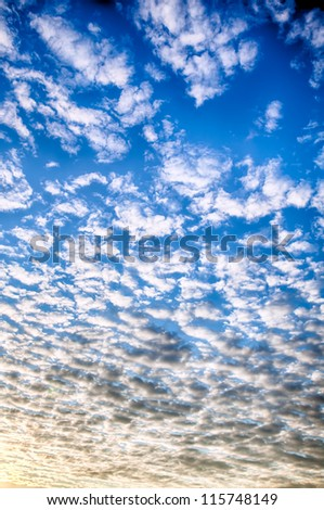 Beautiful striped clouds. HDR image - stock photo