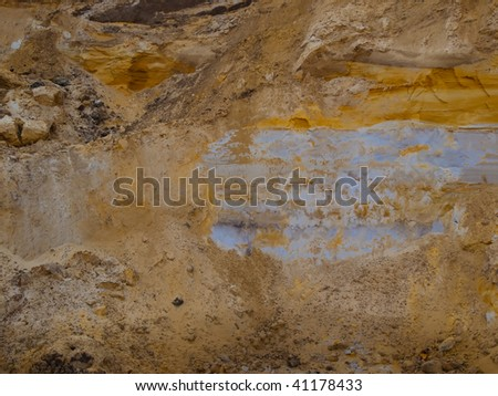 Beautiful structural background ground layers in a cut - stock photo