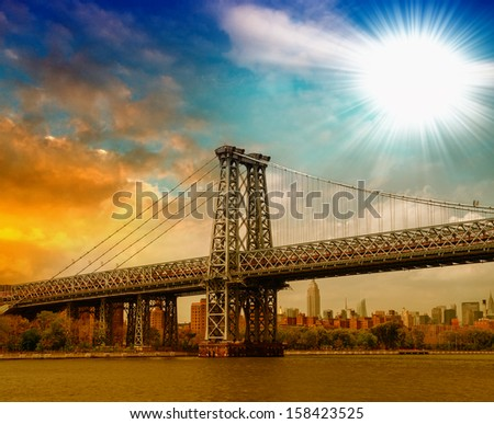 Beautiful structure of Manhattan Bridge against a dramatic colourful sky - New York. - stock photo