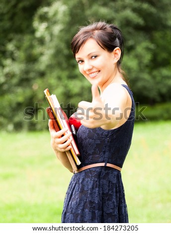 beautiful student girl in the park - stock photo