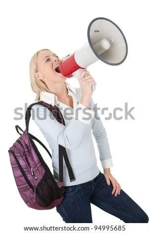 Beautiful student girl shouting in megaphone - stock photo