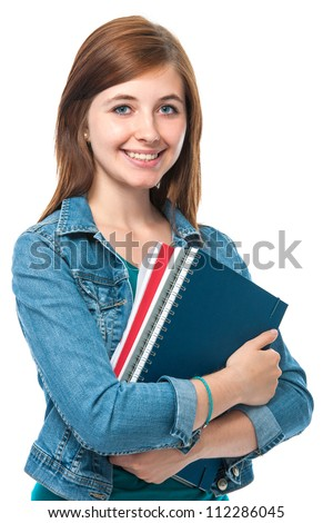 Beautiful student girl with books. Isolated on white - stock photo