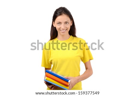 Beautiful student in yellow blouse holding books. Isolated on white. - stock photo