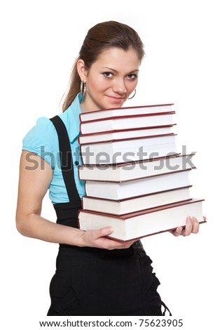 Beautiful student is holding a lot of books isolated on white