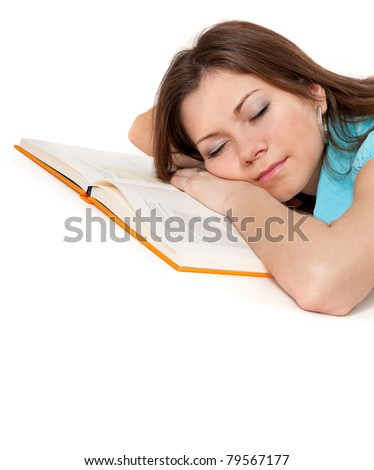 Beautiful student is sleeping on the book isolated on white