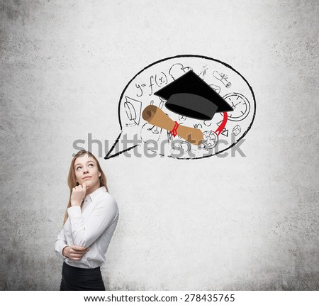 Beautiful student is thinking about graduation and future career. - stock photo