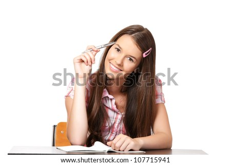 beautiful student learning in school and holding a pen - stock photo