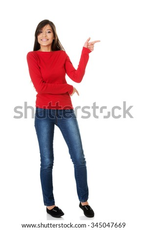 Beautiful student woman pointing aside. - stock photo