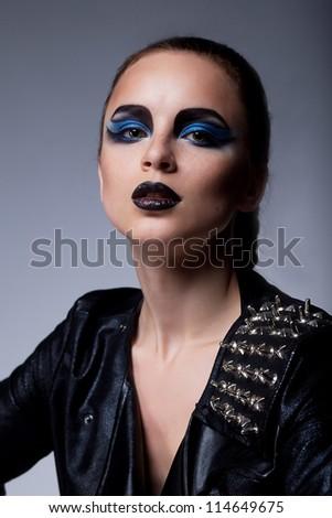 Beautiful stylish brunette arrogant woman with blue eyes make-up - stock photo